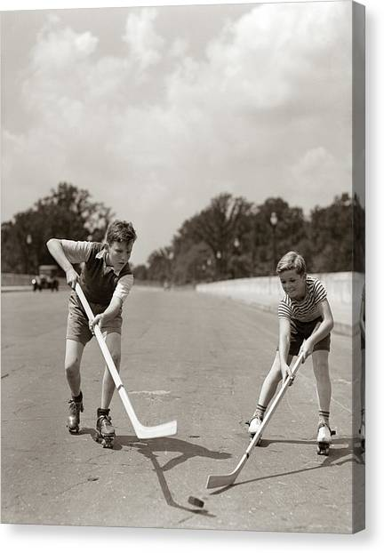 Roller Skating Canvas Print - 1930s 1940s 2 Boys With Sticks And Puck by Vintage Images