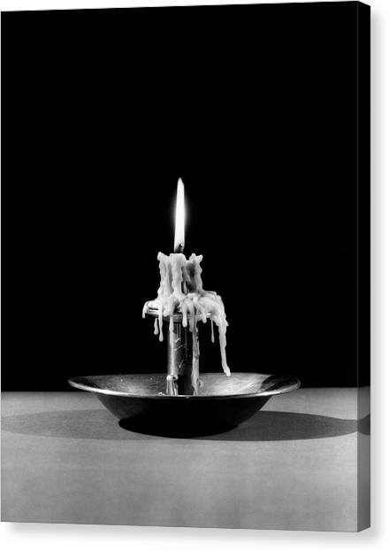 Candle Stand Canvas Print - 1930s Still Life Of Lit Candle Burned by Vintage Images