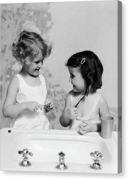 Toothbrush Canvas Print - 1930s Two Girls At Bathroom Sink by Vintage Images