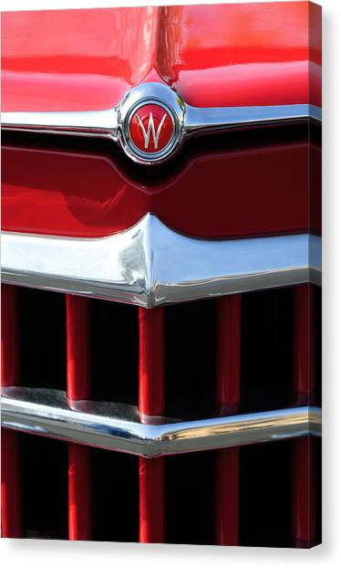 Canvas Print featuring the photograph 1950 Willys Overland Jeepster Hood Emblem by Jill Reger