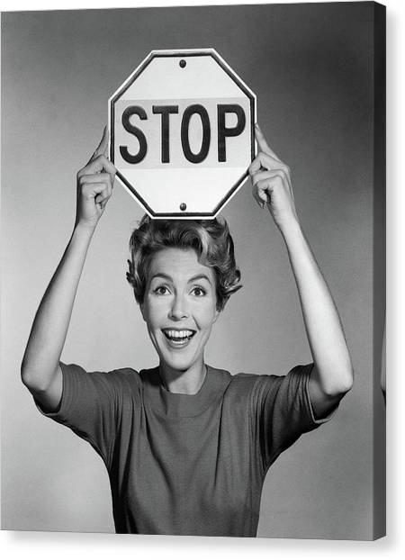 Stop Sign Canvas Print - 1950s 1960s Smiling Woman Holding Stop by Vintage Images
