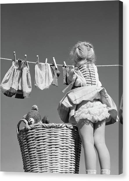 Care Bears Canvas Print - 1950s Back View Of Girl Hanging Laundry by Vintage Images
