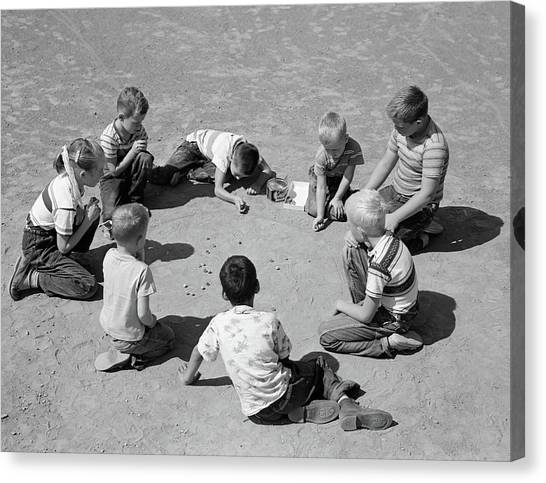 Boy And Girl Canvas Print - 1950s Boys & Girls Shooting Marbles by Vintage Images