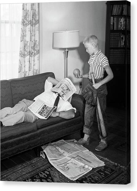 Father And Son Canvas Print - 1950s Father Lying On A Sofa by Vintage Images