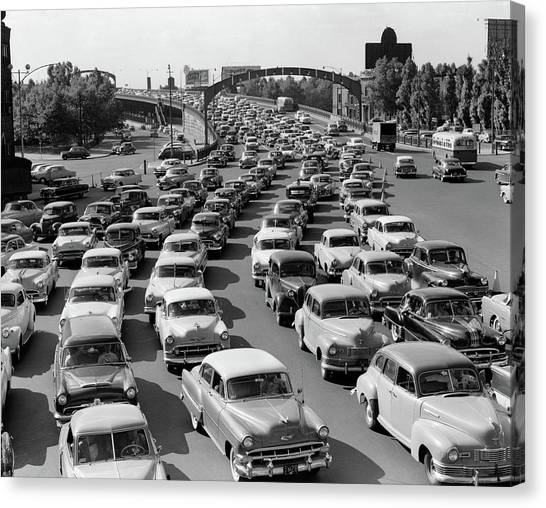 Motoring Canvas Print - 1950s Heavy Traffic Coming by Vintage Images