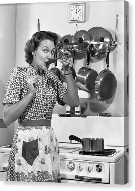 Tasting Canvas Print - 1950s Housewife Cooking Tasting Sauce by Vintage Images