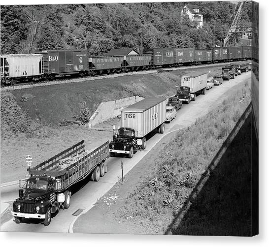 Freight Trains Canvas Print - 1950s Line Of Traffic With Many Trucks by Vintage Images