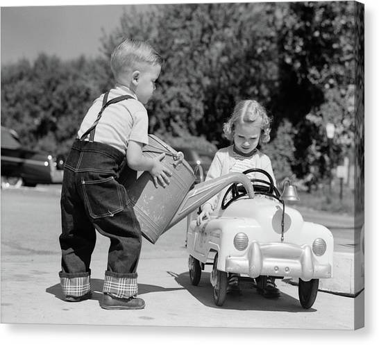 Motoring Canvas Print - 1950s Little Boy Playing Gas Station by Vintage Images
