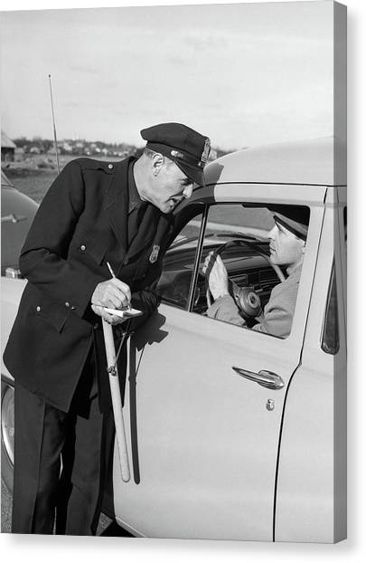 Police Officer Canvas Print - 1950s Policeman With Stopped Motorist by Vintage Images