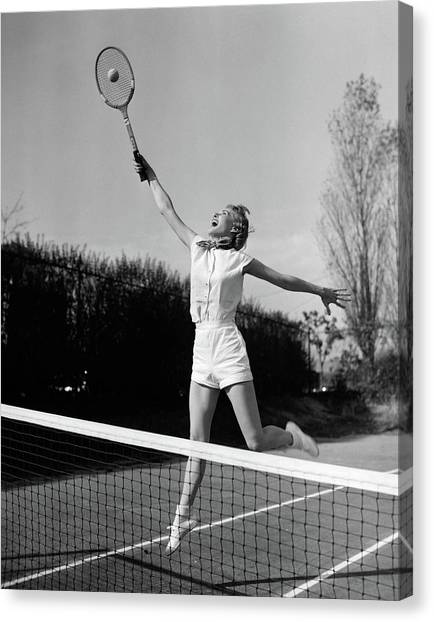 Tennis Racquet Canvas Print - 1950s Woman Jumping To Hit Tennis Ball by Vintage Images
