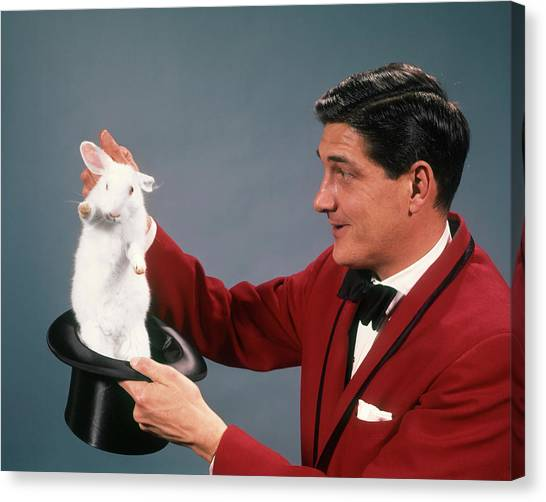 Hat Trick Canvas Print - 1960s 1970s Man Magician Wearing Red by Animal Images
