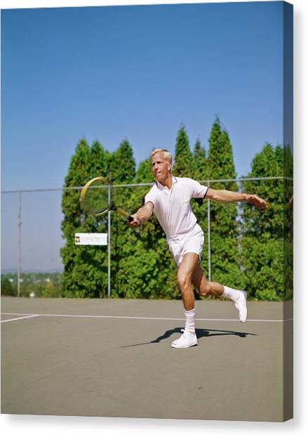 Chain Link Fence Canvas Print - 1960s Blonde Man Wearing Tennis Whites by Vintage Images