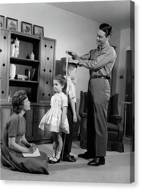 Big Brother Canvas Print - 1960s Father Measuring Daughter & Son by Vintage Images