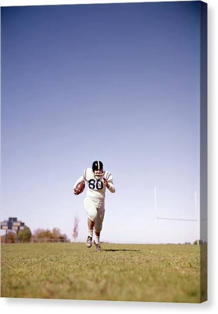 Running Backs Canvas Print - 1960s Football Player Running Towards by Vintage Images