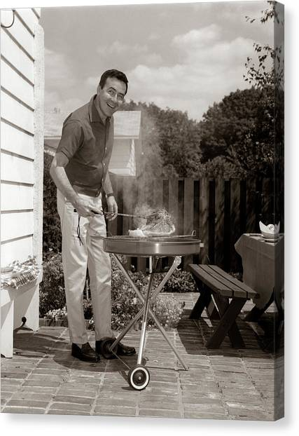 Steak Canvas Print - 1960s Head-on View Of Man Backyard by Vintage Images