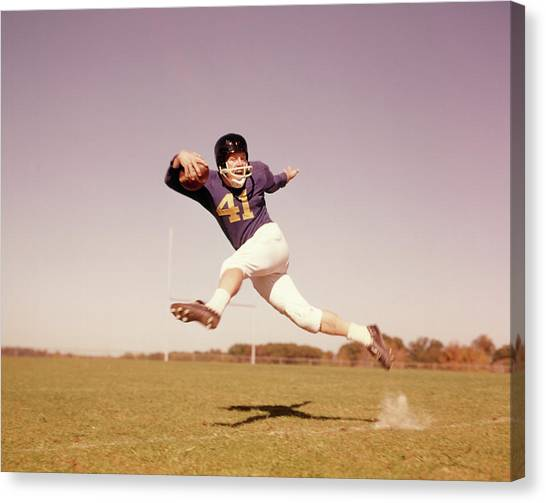 Running Backs Canvas Print - 1960s Jumping Running Football Player by Vintage Images
