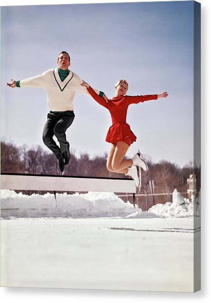 Speed Skating Canvas Print - 1960s Man And Woman Ice Skaters Jumping by Vintage Images