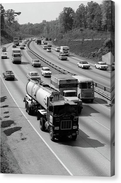 Truck Driver Canvas Print - 1960s Tanker Truck Traveling On Busy by Vintage Images