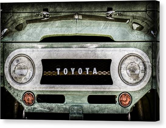 Toyota Canvas Print - 1969 Toyota Fj-40 Land Cruiser Grille Emblem -0444ac by Jill Reger