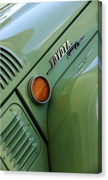Toyota Canvas Print - 1969 Toyota Fj-40 Land Cruiser Side Emblem -0423c by Jill Reger