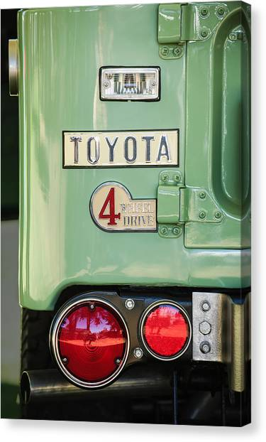 Toyota Canvas Print - 1969 Toyota Fj-40 Land Cruiser Taillight Emblem -0417c by Jill Reger