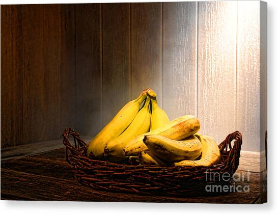Fruit Baskets Canvas Print - Bananas by Olivier Le Queinec