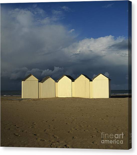 Thunderclouds Canvas Print - Beach Huts Under A Stormy Sky In Normandy. France. Europe by Bernard Jaubert