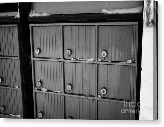 canada post post mailboxes in rural small town Forget Saskatchewan Canada Canvas Print by Joe Fox