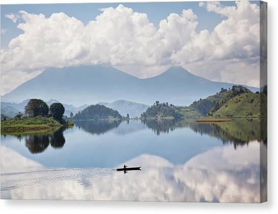 Dugouts Canvas Print - Dugout Canoe Floating On Lake Mutanda by Martin Zwick