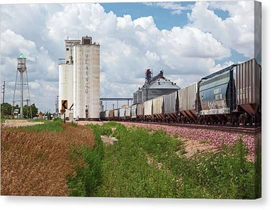 Grain Elevators And Railway Canvas Print by Jim West