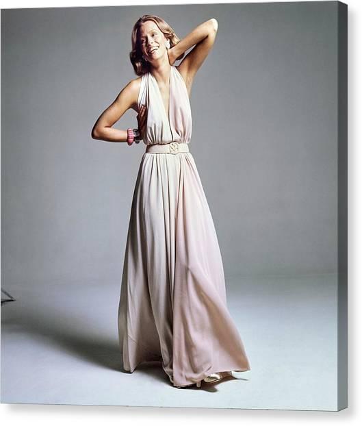 Lauren Hutton Wearing A Galanos Dress Canvas Print by Bert Stern