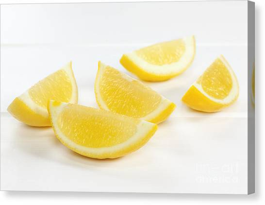Lemons Canvas Print - Lemon Wedges On White Background by Colin and Linda McKie