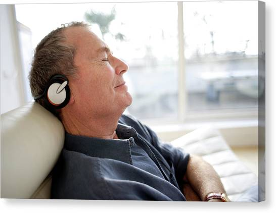 Headphones Canvas Print - Man Using Headphones by Ian Hooton/science Photo Library