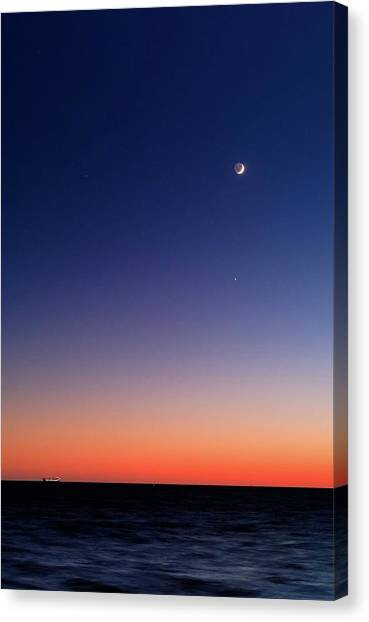 Sunrise Horizon Canvas Print - Moon And Venus At Sunrise by Luis Argerich
