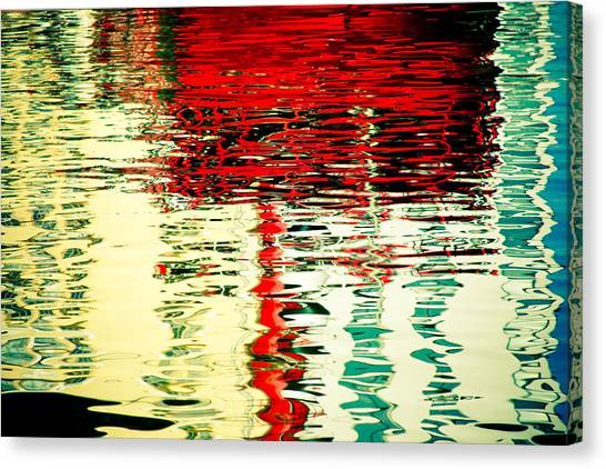 Reflection In Water Of Red Boat Canvas Print