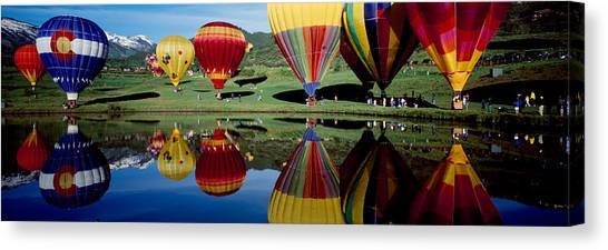 Reflection Of Hot Air Balloons Canvas Print