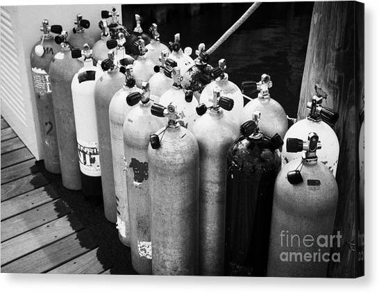 Scuba Air Tanks Lined Up On Jetty To Be Filled In Harbour Key West Florida Usa Canvas Print by Joe Fox