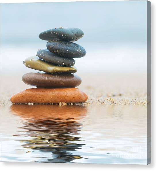 Peace Tower Canvas Print - Stack Of Beach Stones On Sand by Michal Bednarek