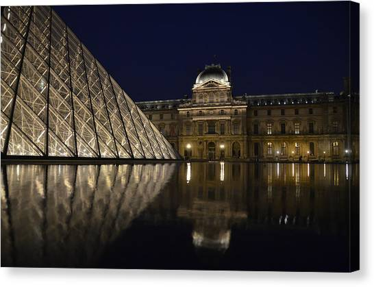 The Louvre Palace And The Pyramid At Night Canvas Print