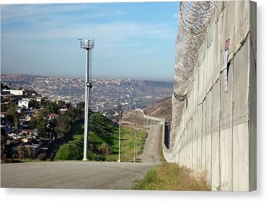 Border Wall Canvas Print - Usa-mexico Border Surveillance by Jim West