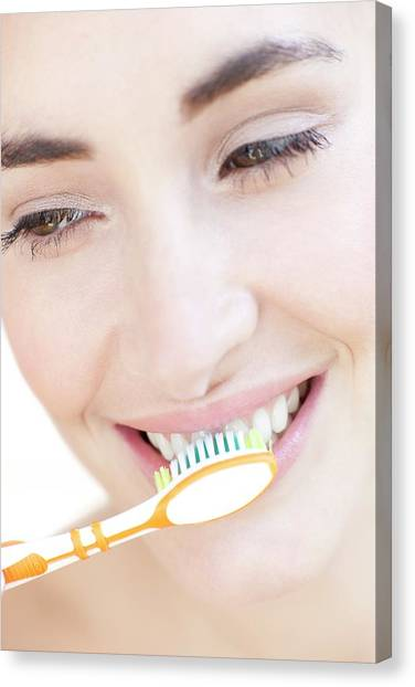 Toothbrush Canvas Print - Woman Brushing Her Teeth by Ian Hooton/science Photo Library