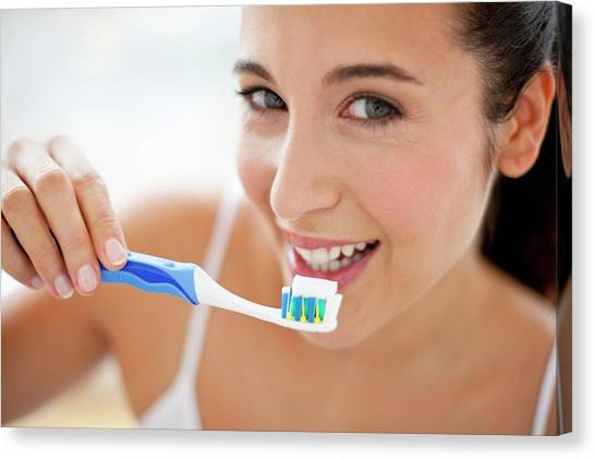 Toothbrush Canvas Print - Woman Brushing Teeth by Ian Hooton