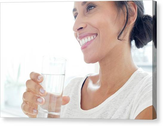 Woman With Glass Of Water Canvas Print by Science Photo Library