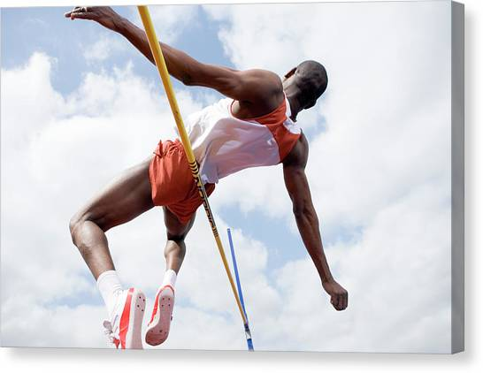 Athlete Performing A High Jump Canvas Print by Gustoimages/science Photo Library