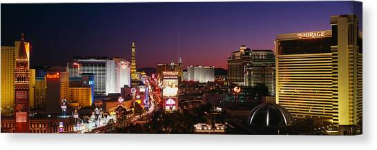 Mirage Canvas Print - Buildings Lit Up At Night, Las Vegas by Panoramic Images