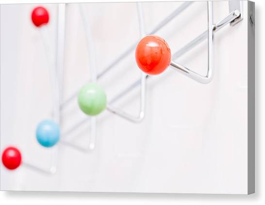 Coat Hanger Canvas Print - Clothes Pegs by Tom Gowanlock