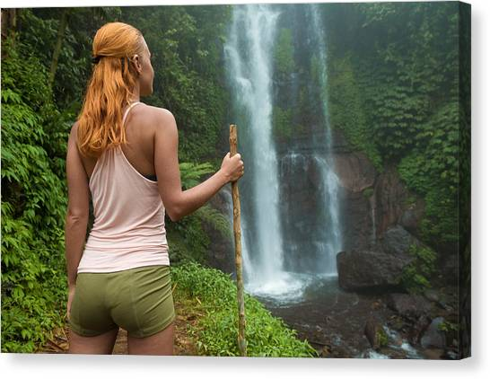 Hailstorms Canvas Print - Female Adventurer Looking At Waterfall by Nikita Buida