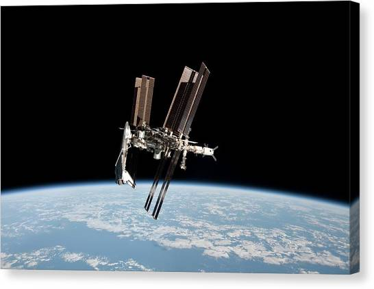 Iss And Space Shuttle Canvas Print by Nasa/science Photo Library
