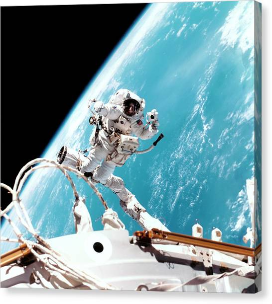 Space Suit Canvas Print - Iss Space Walk by Nasa