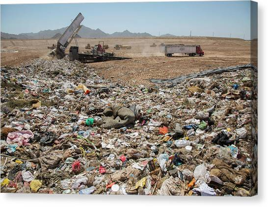 Dump Trucks Canvas Print - Landfill Waste Disposal Site by Peter Menzel